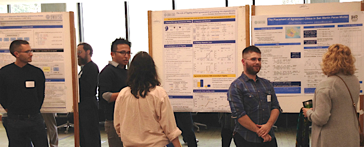 Graduate students presenting posters on their research